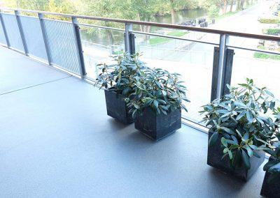 Ny akrylbelægning til altan på Papirfabrikken